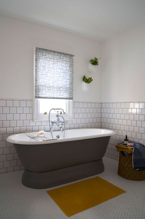 Modern Grey and White bathroom with a blue pattern Roller Blind in front of a free standing bath