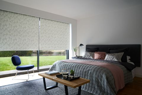 Pink Blush Bedroom with wide windows dressed with grey pattern roller blinds