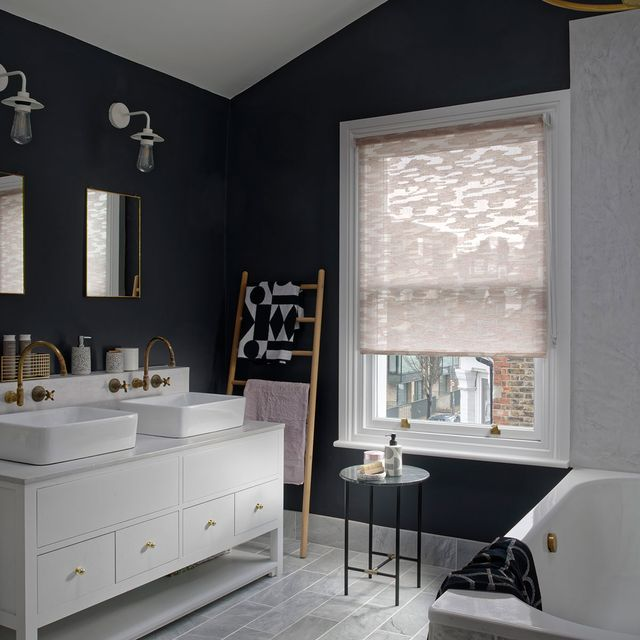 Luxe His and Hers bathroom with pink roller blinds in a pink blush fabric
