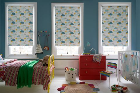 Colourful Children's bedroom and playroom with three windows dressed with Rainbow Print Roller Blinds