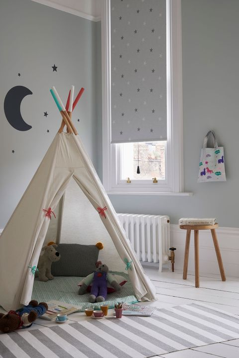 Children's room with a Patterned Roller Blind in twinkle star fabric