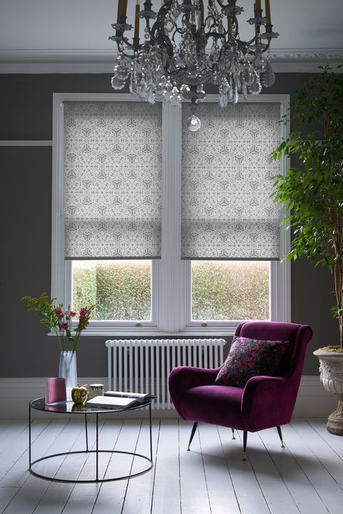 Traditional chic living room with sash windows dressed with grey roller blinds