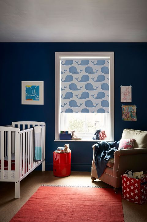 Children's Bedroom Nursery with a blue pattern blackout blind