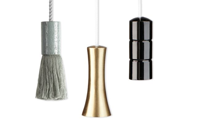 Three curtain pull in different styles and colours including silver, brass and black