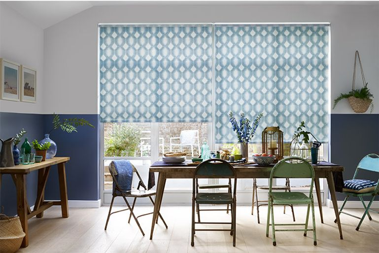 Blue made to measure window blind in the dining room