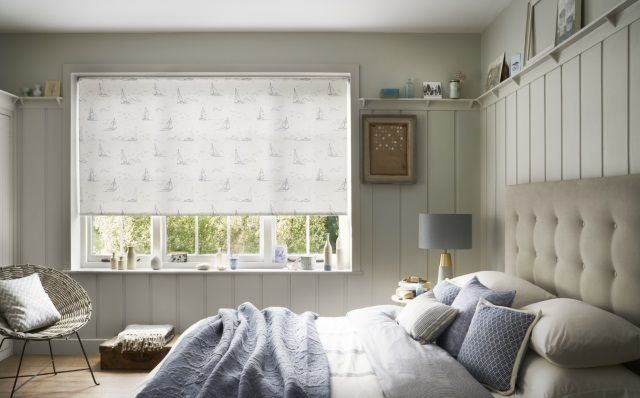 bedroom with white coastal style roller blinds with boat printed pattern