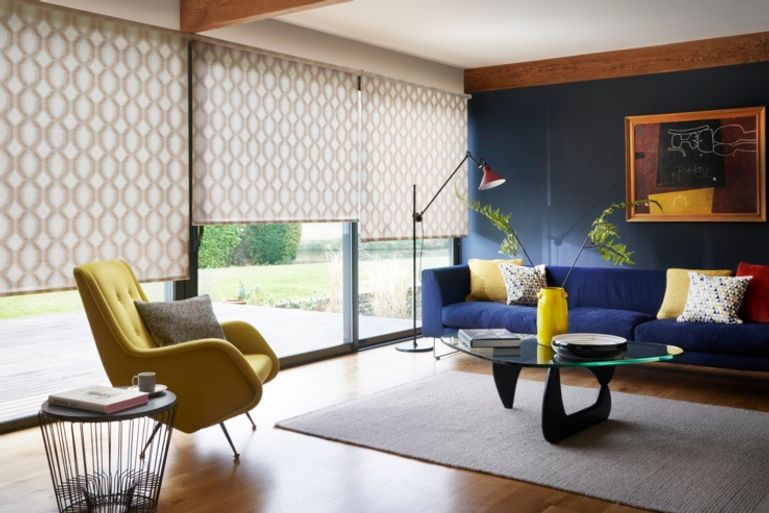 light orange roller blinds in a living room window