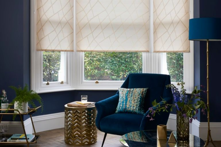 zimmer gold orange roller blinds in a luxuriously decorated living room window