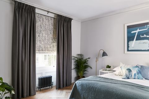 Minimalist bedroom with velvet fabric roman blinds and curtains