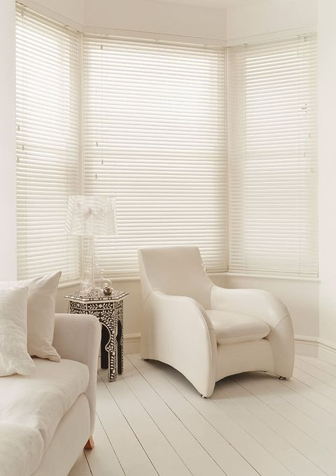 Modern living room with clean lines and fine white wooden blinds