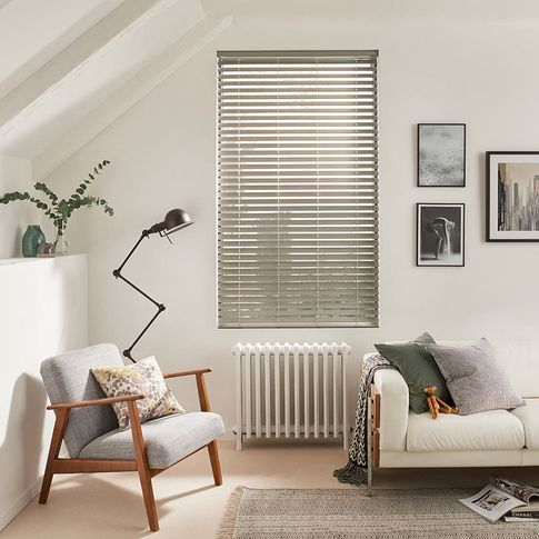 Modern minimalist living room with silver Venetian blinds