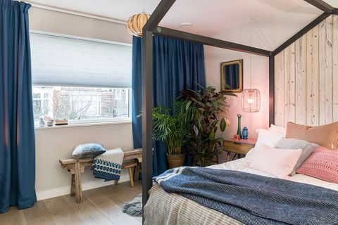 Scandi luxe bedroom with blue pleated blinds
