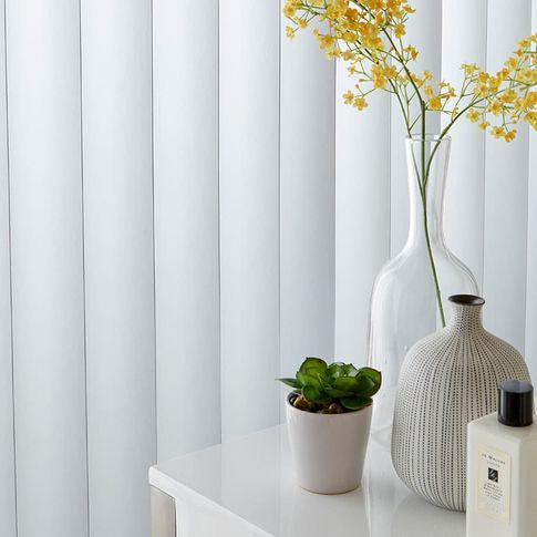 Close up white vertical blinds
