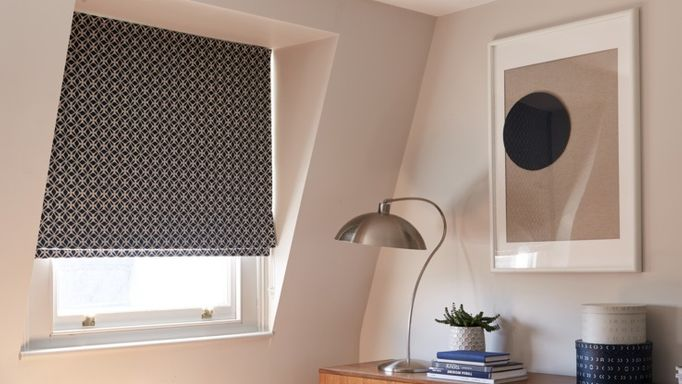 black & white roman blind in a home office window
