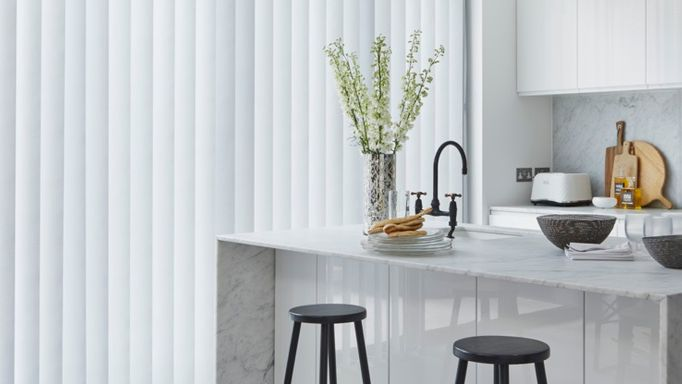 white vertical blinds in a kitchen window with a modern style breakfast bar