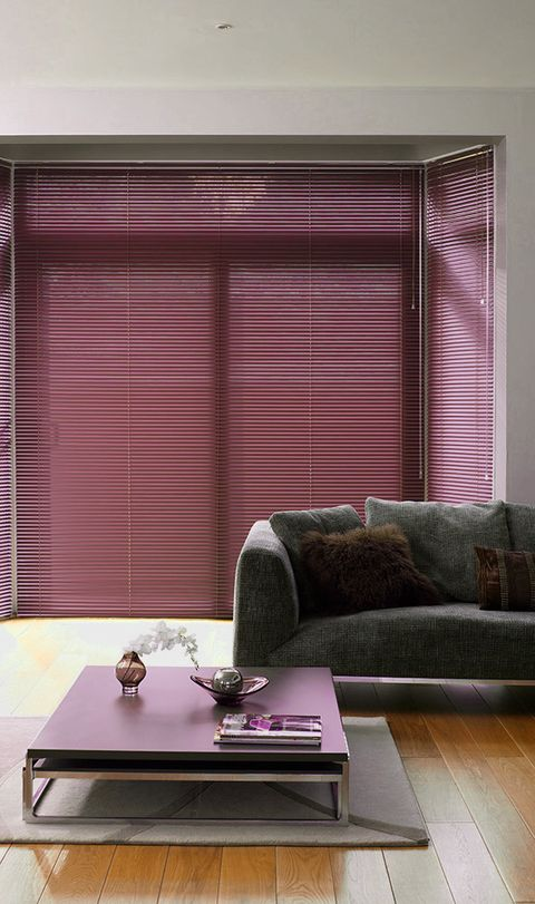 Close up of a window featuring a damson coloured Venetian blind