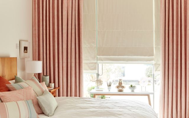 Bright Bedroom with Blackout Curtains in Origami Persimmon Fabric paired with Tetbury Ivory Roman Blinds