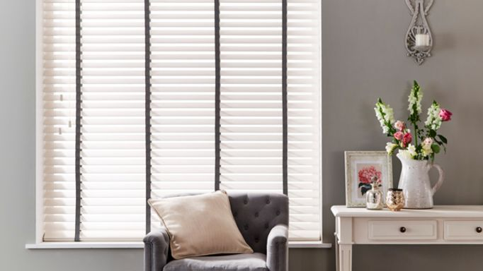cream Venetian wooden blinds in a hallway window