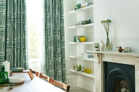 Green and white modern curtains in a dining room