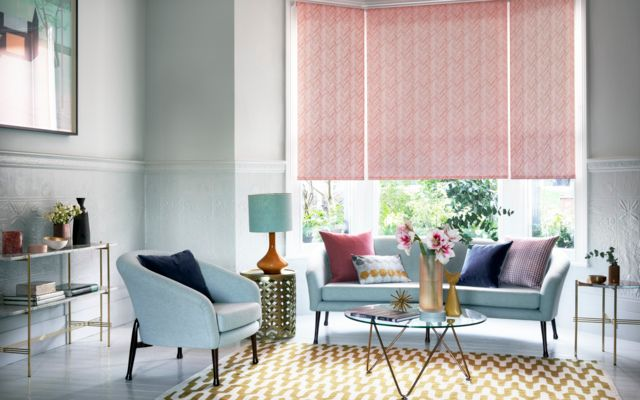 siesta salmon roller blinds in a stylish living room bay window