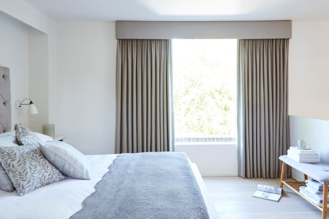 Large bedroom with full length Blackout Curtains blocking out the bright sun