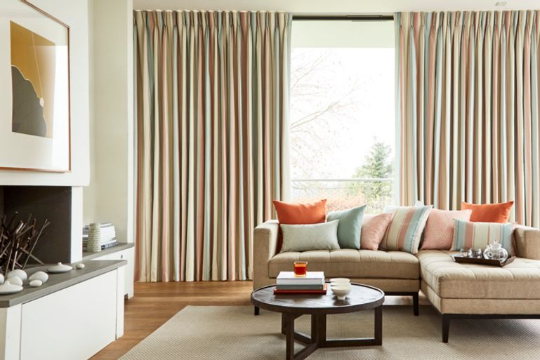 Neutral Living Room decorated with Pastel Striped Mishima Dawn Curtains