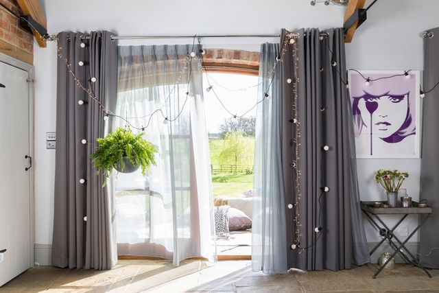 Jo Wiley collaboration Hillarys grey curtains in a large patio window