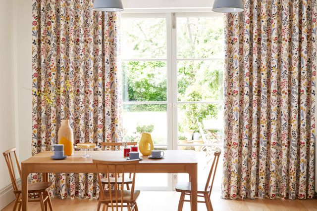 Ester Cranberry Multi Coloured Patterned Curtains in a Dining Room with French Doors