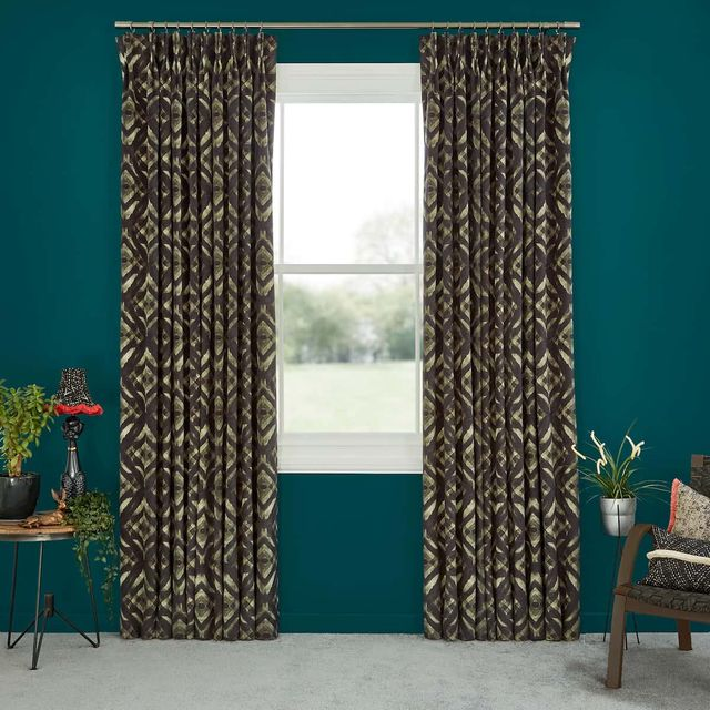 Abigail Ahern Harkness Gasoline Curtains set against dark teal walls in minimal living room