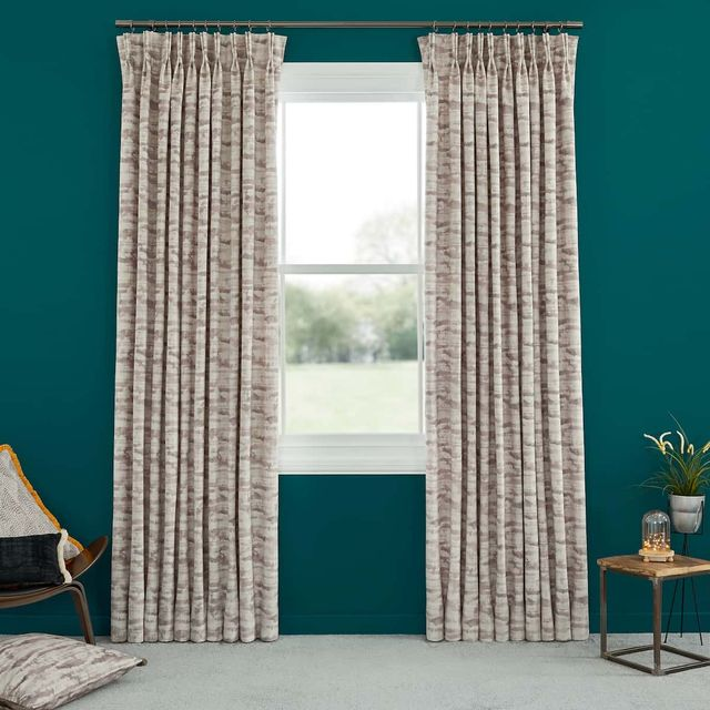 Abigail Ahern Jago Tabac Curtains set against dark teal walls in living room
