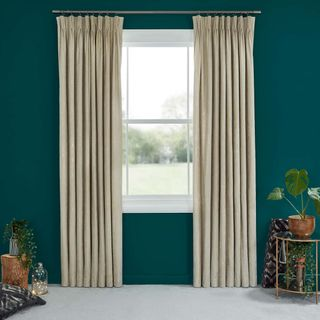 Abigail Ahern Lucien Dust Curtains set against dark teal walls in living room