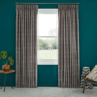 Abigail Ahern Morton Tar Curtains set against dark teal walls in living room