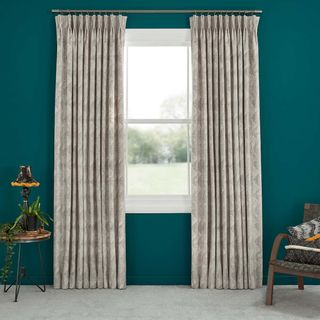 Abigail Ahern Asaro Min Curtains set against dark teal walls