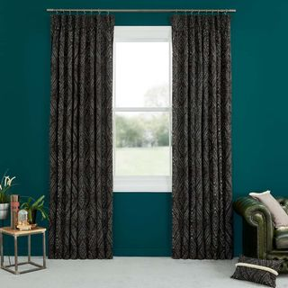 Abigail Ahern Beats Haze Curtains set against dark teal walls