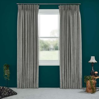 Abigail Ahern Cley Donkey Curtains set against dark teal walls