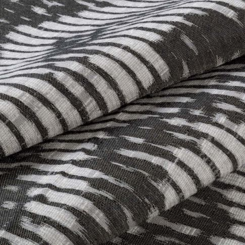 Black and white striped Cadillac Noir swatch on a ream of fabric