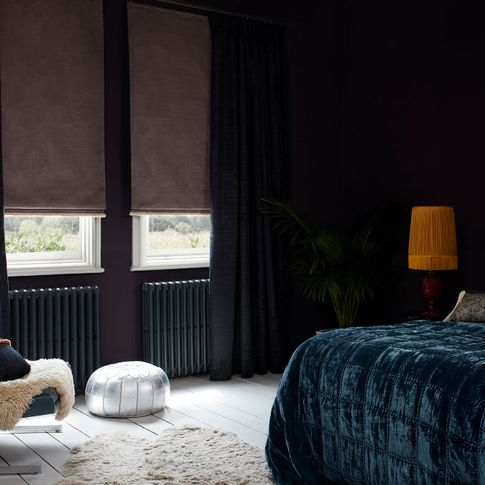 Dark edgy bedroom with luxurious velvet fabrics and soft pink roman blinds