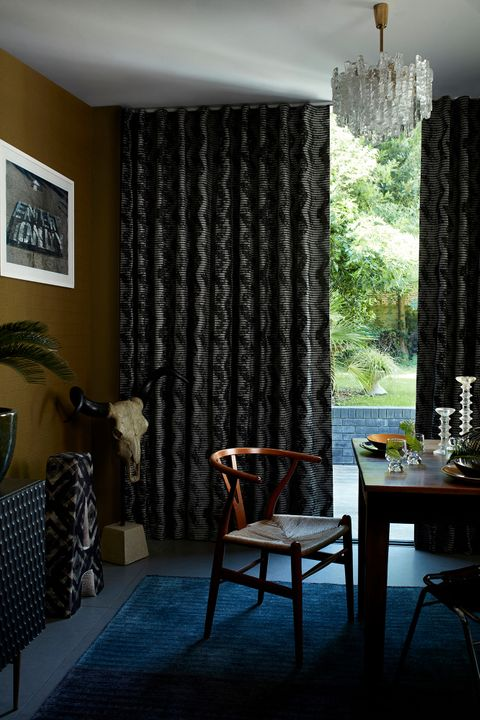 Dark and Edgy Dining Area with Black Pattern Wave Curtains in Cadillac Noir Fabric from the Abigail Ahern Collection