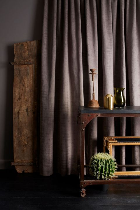 Rustic Space with dark painted walls and mauve velvet curtains