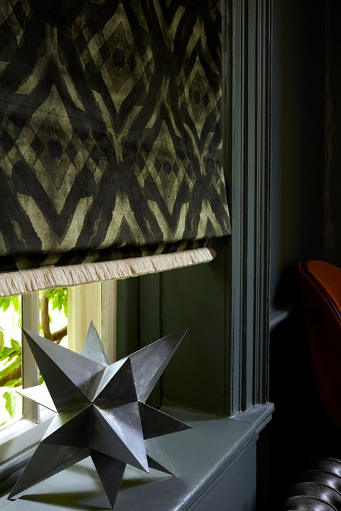 Close up of Abigail Ahern dark green patterned roman blinds in luxurious velvet fabric