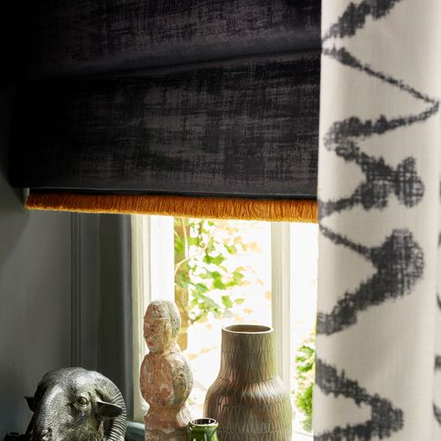 Close up of Abigail Ahern dark grey roman blinds