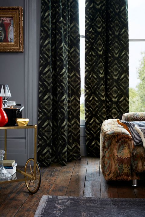 Dark and Eccentric Living Room Decorated with Green and Black velvet curtains from the Abigail Ahern collection