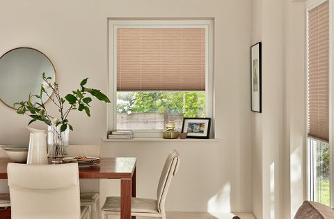 Modern dining room with windows dressed with taupe perfect fit blinds
