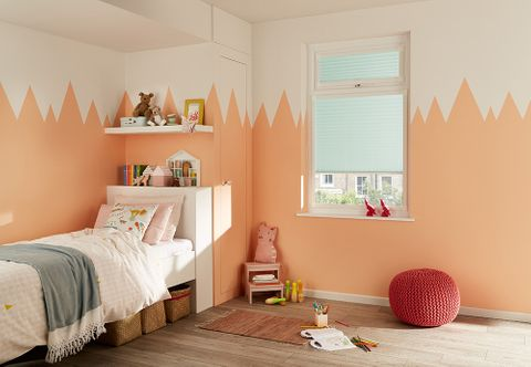 Children's bedroom with colourful decor and pastel blue perfect fit blinds