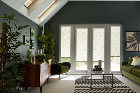 Dark tropical design living room with french doors dressed with green perfect fit blinds