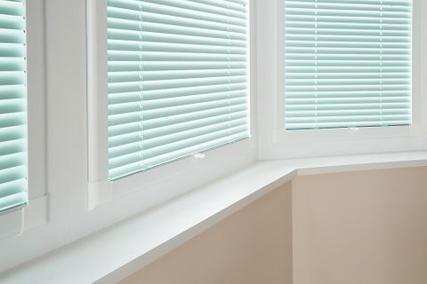 Close up of perfect fit blinds in pastel green fabric