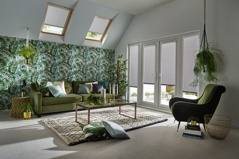 Living room with tropical design and patio doors dressed with grey perfect fit blinds