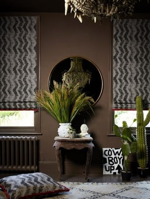 Cadillac Noir Roman blinds and cushion with Colette Vixen fringing