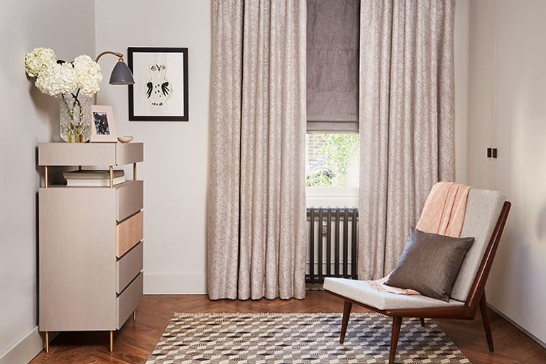 Guest room with Echo Zinc Metallic curtains and Opulence Smoke Roman blinds