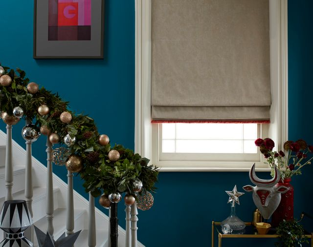 Lucien Dust blinds hung on window by festive staircase